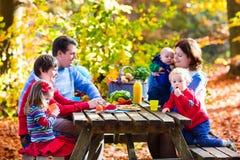 Family having picnic in autumn Stock Photos