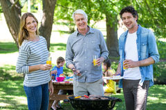 Family having a picnic with barbecue Royalty Free Stock Photos