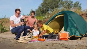 Family having picnic during camping trip stock video