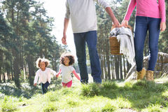 Family Having Picnic In Countryside Stock Photo