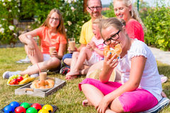 Family having picnic in garden front of their home Royalty Free Stock Photography