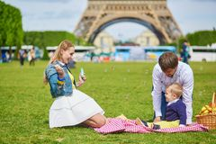 Family having picnic in Paris Royalty Free Stock Image