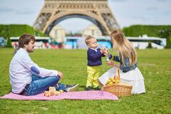 Family having picnic in Paris Stock Photo