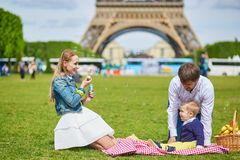 Family having picnic in Paris Royalty Free Stock Images