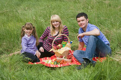 Family having picnic in park. Parents and child on picnic in the forest. Mother, father and daughter relaxing Royalty Free Stock Image