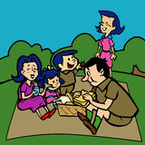 Family having a picnic in a park. Royalty Free Stock Photography