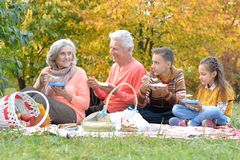 Family having a picnic in the park. In autumn Stock Photo