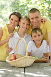 Family having picnic. Portrait of a happy family having picnic in summer Stock Photography