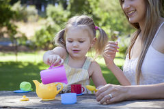 Family having picnic in summer park. And pretend tea party Stock Images