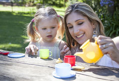 Family having picnic in summer park. And pretend tea party Royalty Free Stock Photo