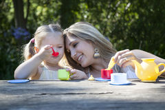 Family having picnic in summer park. And pretend tea party Royalty Free Stock Image