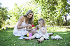 Family having picnic in summer park. And pretend tea party Stock Photography
