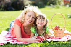 Family having picnic in summer park Stock Image