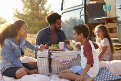 Family having a picnic beside their camper van Royalty Free Stock Images