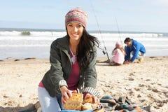 Family Having Picnic On Winter Beach Royalty Free Stock Photo
