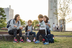 A family is having a picnic in Yokohama Bay side. Stock Photo