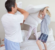 Family having a pillow fight Royalty Free Stock Images