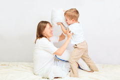 Family having pillow fight Royalty Free Stock Photography