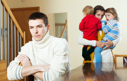 Family having quarrel at home. Family of four with two children having quarrel at home Stock Image