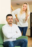 Family having quarrel at home. Married couple having quarrel about adultery Royalty Free Stock Image