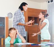 Family having quarrel at home. Family of three having quarrel at home Royalty Free Stock Photos