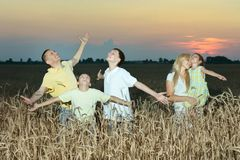 Family having rest in field Royalty Free Stock Photography