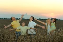 Family having rest in field Stock Photography