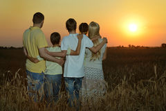 Family having rest in field Royalty Free Stock Photo