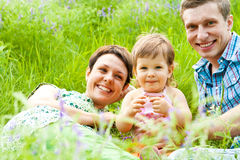 Family having rest in the meadow Stock Images