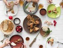 Family having roasted chicken wings for dinner Stock Photography