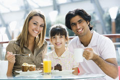 Free Family Having Snack At Cafe Stock Photo - 5210140