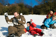 Family having a snowball fight Royalty Free Stock Photography