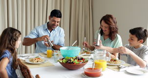 Family having a spaghetti dinner together Royalty Free Stock Photography