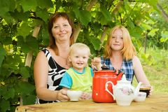 Family having tea Royalty Free Stock Photo