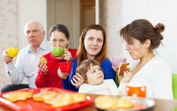 Family having tea with cakes Stock Photos