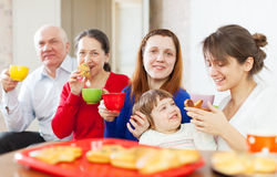 Family having tea with cakes   together Royalty Free Stock Photos