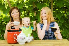Family having tea  at pergola Royalty Free Stock Photography