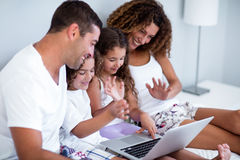 Family having video chat on laptop Stock Images