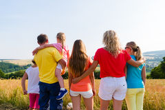 Family having walk looking at landscape of their home Royalty Free Stock Photography