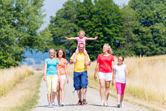 Family having walk on path in summer Royalty Free Stock Images