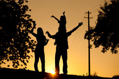 Family having walk at sunset Stock Images