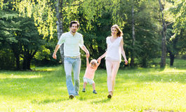Family having walk together in summer Stock Photo
