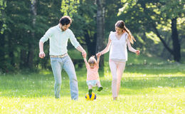 Family having walk together in summer Stock Image
