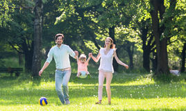 Family having walk together in summer Royalty Free Stock Photo