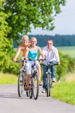 Family having weekend bicycle tour outdoors Royalty Free Stock Image