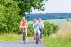Family having weekend bicycle tour outdoors Royalty Free Stock Photography