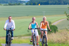 Family having weekend bicycle tour outdoors Stock Image
