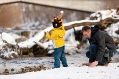Family having winter walk at river Stock Photo