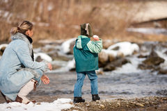 Family having winter walk at river Royalty Free Stock Photo