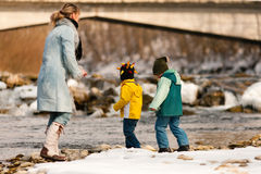 Family having winter walk at river Stock Image